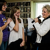 Teri Smith and Julia MacFarlane participate during a fundraiser with Medium Bonnie Page. The event was to raise efunds for for the Holiday Spreaders group from the United Way Youth Venture from Leominster High School. SENTINEL & ENTERPRISE / Ashley Green