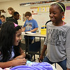 Meera Nair, a Tyngsboro Elementary School student with cerebral palsy chats with her classmate Dahkya Zoua, 10, during her visit on Tuesday, October 3, 2017. She has not been able to attend school this year due to an operation she had to have. SUN/JOHN LOVE