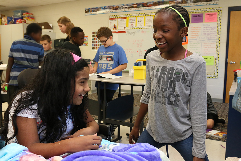 . Meera Nair, a Tyngsboro Elementary School student with cerebral palsy chats with her classmate Dahkya Zoua, 10, during her visit on Tuesday, October 3, 2017. She has not been able to attend school this year due to an operation she had to have. SUN/JOHN LOVE