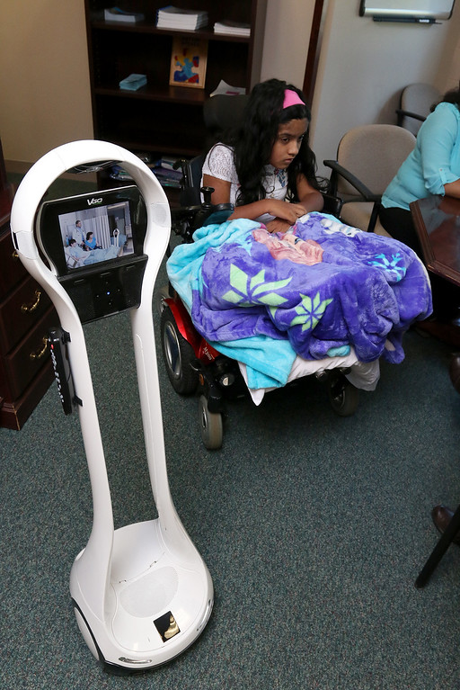 . Meera Nair, a Tyngsboro Elementary School student with cerebral palsy has not been able to attend school this year due to an operation she had to have. She has been able to keep up with her work by the means of this robot called VGo.  SUN/JOHN LOVE