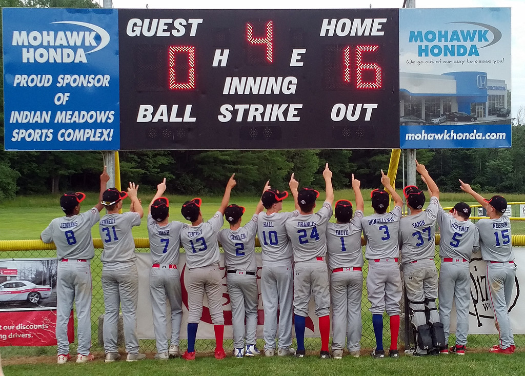 . STAN HUDY - SHUDY@DIGITALFIRSTMEDIA.COMThe Spring Baseball 12U squad points to the scoreboard after capturing it\'s third straight Eastern New York Cal Ripken Monday night at Indian Meadows Park in Glenville.