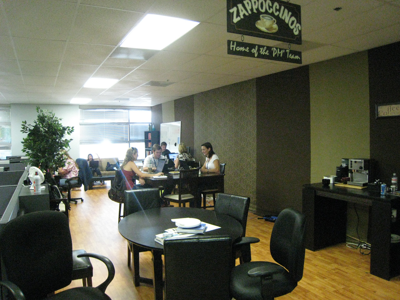 Employees are given a budget to customize their offices however they want.  This area was turned into a mini starbucks!