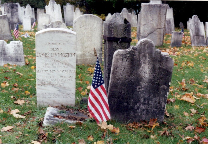 The grave markers for Col. Livingston can be found by looking within a set of six granite posts in the cemetery.