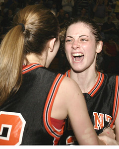 TEARS OF JOY.   #33 Kathleen Neyens and #21  Amanda Hodgman celebrate victory.