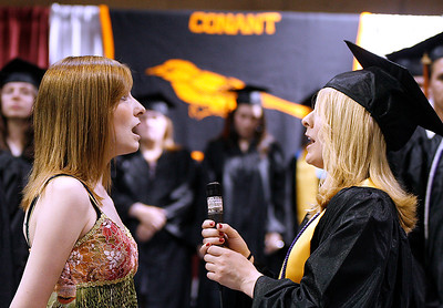 6/12/09. Hooper foto. News.  Conant High School Graduation.  The National Anthem was sung by sisters Elizabeth Lanza, left, Class of 2011 and Allison Lanza, right, Class of 2009.