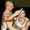 3/10/07. Hooper foto. Sports.  Matt Oullette, left, celebrates with Trevor Young after the game in being #1 in the state.