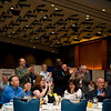 Attendees applaud during the awards breakfast