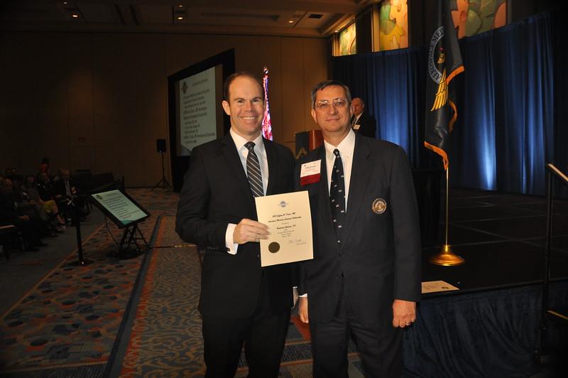 Benjamin Johansen, D.O., receives the 2015 Jeffrey R. Davis, M.D.,  Aerospace Medicine Endowed Scholarship from AsMA president, Philip J. Scarpa, Jr., M.D.