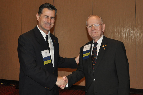 Dr. Belland congratulates Daniel Lestage on 50 years of membership