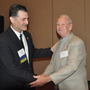 Dr. Belland congratulates David Gillis on his  50 years of membership.