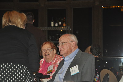 Lois and Royce Moser listen intently at the Welcome Reception.
