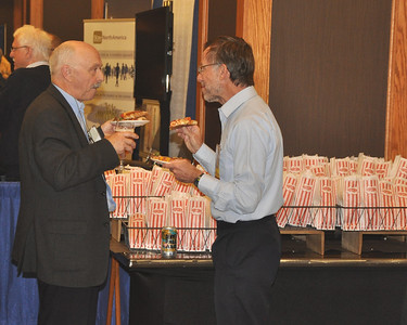 Claude Tibeault and Tony Evans enjoying pizza at the Welcome Reception.