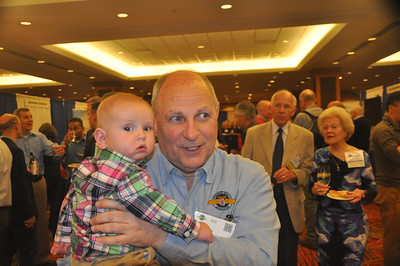 Jeff Sventek finds a baby at the Welcome Reception.