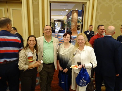 Cathy DiBiase with the first family of AsMA, Jack Goble, Rowan Goble, and AsMA President Vlaeries Martindale at the welcome reception.