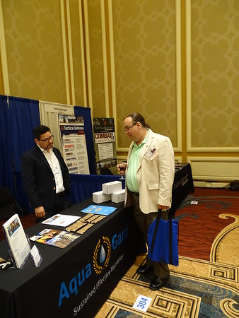 Welcome reception #8: Jack Goble chats with Gabriel Castillo from Aqua Innovations Ltd.
