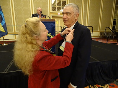 50 Year pin is presented to Dr. Russell B. Rayman by Valerie Martindale.