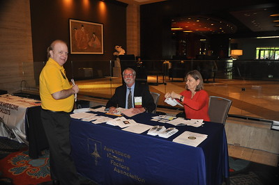 The Aerospace Human Factors Association table, manned by Tom Nesthus and Annette Sobel.