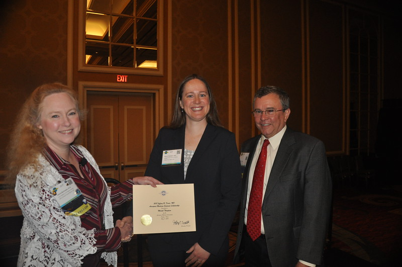 The 2018 Jeffrey R. Davis, MD, Endowed Scholarship was presented to Moriah Thompson, M.D., by Valerie Martindale and Jeffrey Davis.