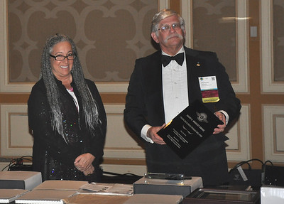 Tracy Dillinger and Al Parmet organize the awards for presentation.