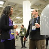 Work and play at the UNAVCO booth during the 2016 AGU annual meeting in San Francisco. (Photo/Beth, Bartel, UNAVCO)