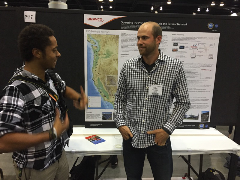 2012 and 2013 RESESS intern Nathan Mathabane talks with UNAVCO borehole manager Mike Gottlieb  at the 2014 annual GSA meeting in Vancouver, B.C. (Photo/Aisha Morris, UNAVCO)