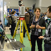 UNAVCO TLS data engineer Marianne Okal demos terrestrial laser scanning at the UNAVCO booth at GSA 2014 in Vancouver, B.C. (Photo/Beth Bartel, UNAVCO)