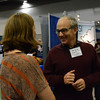 UNAVCO oureach specialist Beth Bartel talks with EarthScope National Office director Ramon Arrowsmith at the UNAVCO booth at the 2014 GSA meeting in Vancouver, B.C. (Photo/Aisha Morris, UNAVCO)