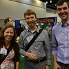 UNAVCO TLS project manager Christopher Crosby (right) with fellow Whitman College alumni Emily Ward and Reed Burgette (UNAVCO represetative of member institution New Mexico State University), at the UNAVCO booth at the 2014 GSA in Vancouver, B.C. (Photo/Beth Bartel, UNAVCO)