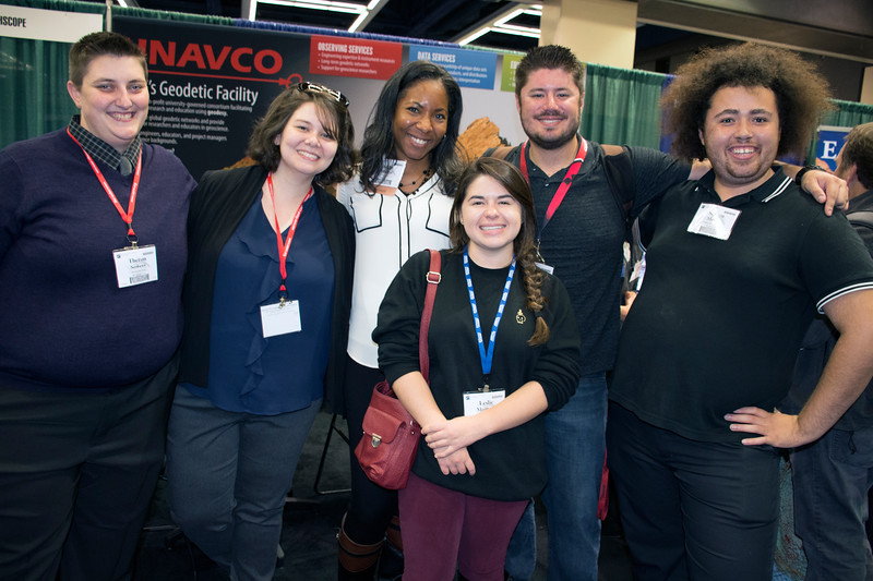 RESESS interns reunite at the UNAVCO booth during the 2017 annual meeting of the Geological Society of America in Seattle, WA.  From left to right: Theron Sowers (2017), Fatima Niazy (2017), Aisha Morris (Director), Leslie Montoya (2016), Wesley Weisberg (2014), Steven Moran (2017).  (Photo/Daniel Zietlow, UNAVCO)