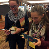 SSA 2017 attendees marvel at the wonderous UNAVCO lenticular rulers that are more than first meets the eye; rotate them, and they alternatively display global earthquakes, velocities, and strain rates. (Photo/Wendy Bohon, IRIS)