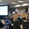 UNAVCO's Christian Walls discusses GPS networks at the 2018 meeting of the Seismological Society of America.  May 26, 2018.  Miami, Florida.  (Photo/Ken Austin, UNAVCO)
