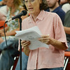 Resident Emily Norton speaks during the meeting that was held at Hawthorne Brook Middle School in Townsend on Thursday evening. The crowd voted a unanimous vote opposing the pipeline. SENTINEL & ENTERPRISE / Ashley Green