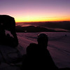 Sun dips below the horizon as the summit plateau is reached after climbing No.2 Gully. Ben Nevis