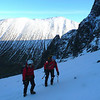 Dom and Neil start up the approach slopes to No. 2 Gully. Carn Mor Dearg in the sunlight behind.