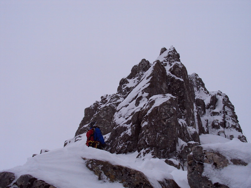 Johnny high on SW Ridge of Douglas Boulder