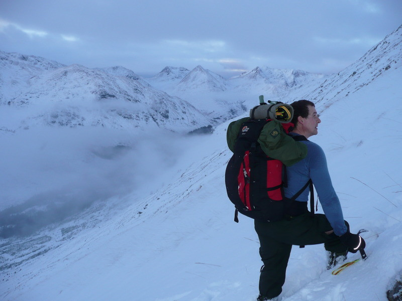 Stewart ascending the steep slopes to Bealach an Lapain. View behind...over Glen Shiel to Sgurr na Sgine and The Saddle