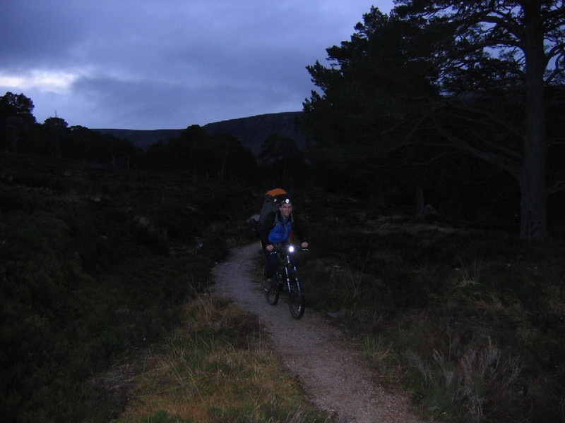 Neil using a bike to take to take the pain out of the approach to Carn Etchachan.