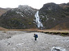 Sue fording the River Nevis with Steall Waterfall in the background.