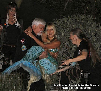 """Shooting the """"A Night for the Oceans"""" Sea Shepherd fund raiser event in Los Angeles, CA in 2010.  Helping Captain Paul Watson with Hannah the Mermaid as they almost fell down the steps. Photo by Kadi Thingvall"""