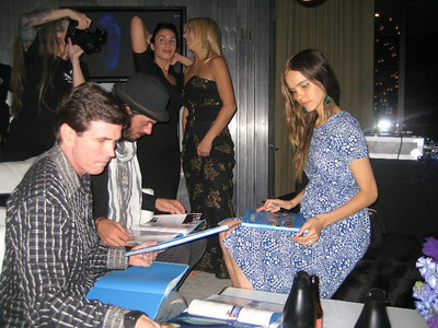 """Shooting the """"A Night for the Oceans"""" Sea Shepherd fund raiser event in Los Angeles, CA in 2010.  Shooting Hannah Mermaid with actress, Isabel Lucas, in the foreground autographing books."""
