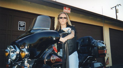 Pretending I know how to ride a full-dress Harley Davidson in 1998.  Photo by Richard Bowman.