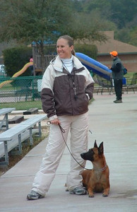 Waiting to compete w/ Brassai at the 2004 North American Ring Association's French Ring Championship at theTriple Crown Dog Academy in Hutto, TX.    Photo by Clarissa Rivasplata.