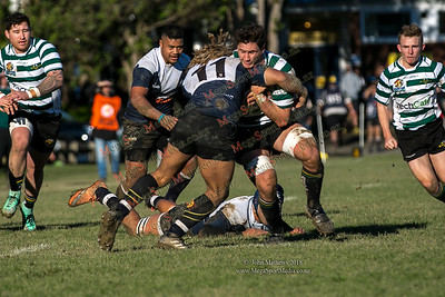 Action from the Wellington Premier  rugby union match (Swindale Shield) between Old Boys University RFC (white) and Petone (blue) at Nairnville Park, Wellington, New Zealand on 2 June 2018. SCORE: Petone 5, OBU 19 Copyright John Mathews 2018 www.megasportmedia.co.nz