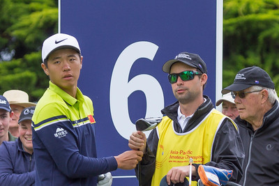 Andy Zhang from China and his caddy Ben Slaven after teeing off the 6th tee on the final day of the Asia-Pacific Amateur Championship tournament 2017 held at Royal Wellington Golf Club, in Heretaunga, Upper Hutt, New Zealand from 26 - 29 October 2017. Copyright John Mathews 2017.   www.megasportmedia.co.nz