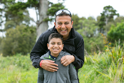 Sam Govind and his son stopping for a photo en route from the 4th green to the next tee on the  final day of the Asia-Pacific Amateur Championship tournament 2017 held at Royal Wellington Golf Club, in Heretaunga, Upper Hutt, New Zealand from 26 - 29 October 2017. Copyright John Mathews 2017.   www.megasportmedia.co.nz