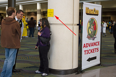 As you came into the Megacon area from the parking lot, you had to walk through the advance ticket sales to get to the onsite tickets sales. How in the world did they expect attendees to know this? I just happened to overhear a staff member give that info out to another attendee. AFTER passing advance sales, I finally see the first sign for onsite sales. There it is in all it's glory, that tiny yellow sign with tiny print. They had 18 windows for ticket sales, why in the world didn't they provide some decent signage to let folks know where to go.