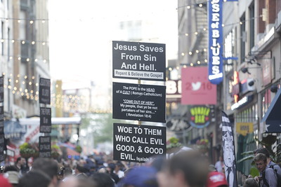 Protester's signs consistently referenced Biblical verses. Photo: Bro. Michael Muhammad