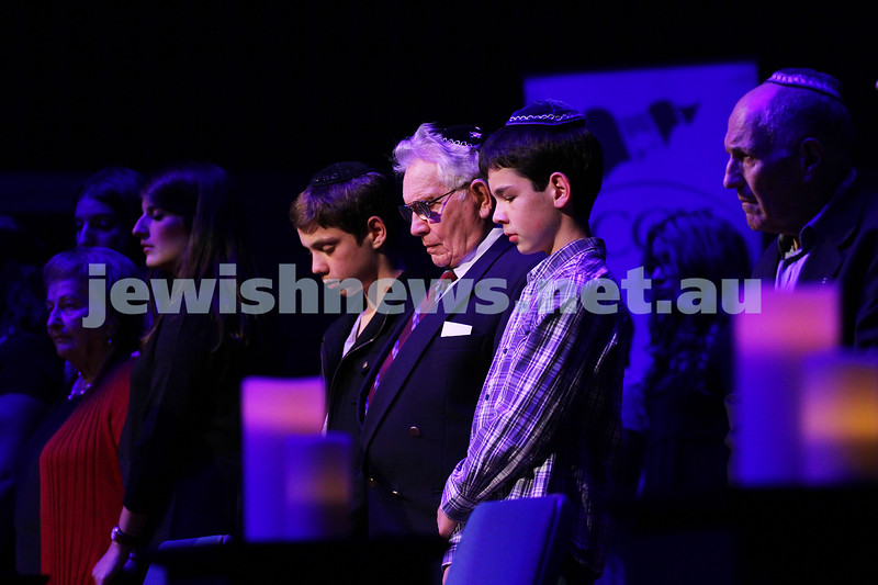 15-4-15. Yom Ha Shoah 2015 memorial at Robert Blackwood Hall, Monash University. Wolf Deane lights one of the six candles with his grand sons. Photo: Peter Haskin