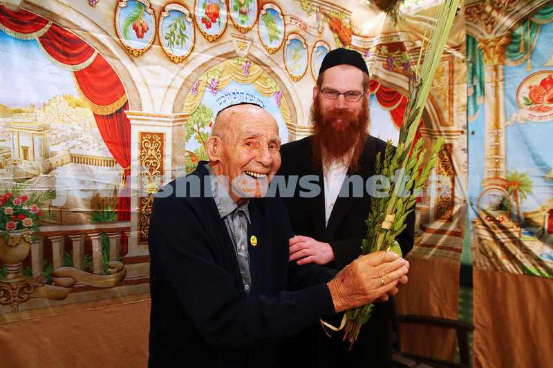 30-9-15. Emmy Monash Aged Care resident Albert Meyer and Rabbi Michoel Stern celebrate Succot with the mitzvah of lulav and etrog. Photo: Peter Haskin
