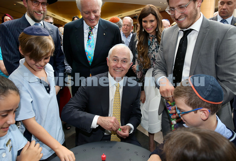 Malcolm Turnbull at Central Shule. The PM playing Dreidel with children. Pic Noel Kessel.